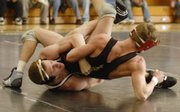 Free State junior Jack Caywood, bottom left, controls his match against Lawrence's Blake Greenfield Tuesday at LHS.