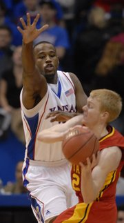 Kansas forward Darnell Jackson, left, looks to disrupt a pass from Iowa State guard Bryan Petersen. Jackson led the Jayhawks with 21 points and 11 rebounds in their 83-59 victory over the Cyclones on Wednesday at Allen Fieldhouse.