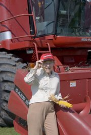 Mildred Armstrong Kalish stands in front of a corn combine at a farm near Garrison, Iowa. Kalish is author of &quot;Little Heathens: Hard Times and High Spirits on an Iowa Farm During the Great Depression.&quot; 