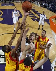 Kansas State's Michael Beasley, middle, takes a shot over Iowa State's Cameron Lee (1) and Jiri Hubalek (33). Beasley scored 33 points in the Wildcats' 82-57 victory Saturday in Manhattan.