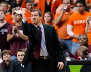 Texas A&M coach Mark Turgeon stakes his fist. A&M snuck by Oklahoma State, 59-56, Saturday in Stillwater, Okla.