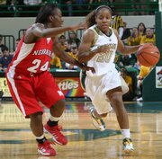 Baylor's Angela Tisdale, right, drives past Nebraska's Dominique Kelley. The sixth-ranked Bears rolled, 76-56, Saturday in Waco, Texas.