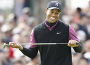 Tiger Woods reacts to a missed birdie putt on the eighth hole during the third round of the Buick Open. Woods fired a 66 on Saturday in San Diego for an eight-stroke advantage.