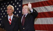 Republican presidential hopeful Sen. John McCain, R-Ariz., right, gives a thumbs-up after Florida Gov. Charlie Crist endorsed him for president Saturday at the Pinnelas County Lincoln Day Dinner in St. Petersburg, Fla.