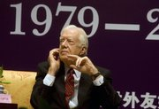 Former U.S. President Jimmy Carter attends a ceremony to mark U.S.-China relations in Beijing in this Dec. 5, 2007, file photo. Led by Carter, Baptists divided for more than a century by theology and race are trying to overcome their differences and show that their faith tradition is broader than the conservative-dominated Southern Baptist Convention. They meet starting today in Atlanta.
