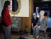 Kansas Gov. Kathleen Sebelius works with a TV crew while she prepares for the Democratic response to the State of the Union at Cedar Crest, the Kansas Governor's Mansion, in Topeka.