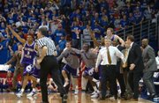 The K-State bench leaps onto the court after defeating Kansas. The Wildcats won two seasons ago in Allen Fieldhouse.