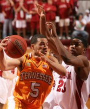 Tennessee's Chris Lofton (5) drives to the basket as Alabama's Demetrius Jemison (23) defends in the first half Tuesday in Tuscaloosa, Ala.