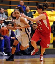 Haskell Indian Nations University guard Sharon Forte drives against Bacone guard Whitnie Stephenson in the first half Tuesday at Coffin Sports Complex.