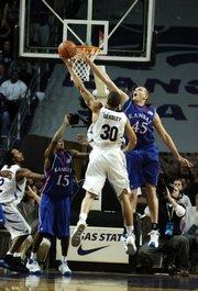 Kansas center Cole Aldrich blocks a shot by Kansas State forward Michael Beasley during the first half Wednesday, Jan. 30, 2008 at Bramlage Colliseum.