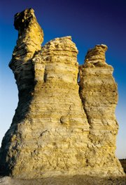 "Castle Rock, a limestone bluff left behind from a vast inland sea thousands of years ago, was named, along with Monument Rock, one of the ""8 Wonders of Kansas"" by 24,000 voters across the country. This limestone outcropping got its name from the similarities in appearance it has to that of an old English castle."