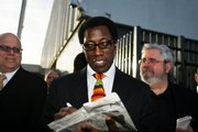 Actor Wesley Snipes signs autographs outside the Golden-Collum Memorial Federal Building and U.S. Courthouse in Ocala, Fla. Deliberations will resume today in Snipes' trial on tax-fraud charges.