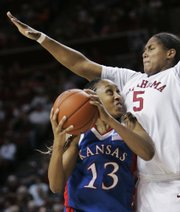 Oklahoma forward Ashley Paris, right, defends Kansas forward Taylor McIntosh.  McIntosh managed just two points in 17 minutes against the Sooners on Wednesday in Norman, Okla.