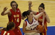 Kansas freshman Krysten Boogaard is surrounded by a trio of Iowa State defenders during Saturday's 53-50 victory.