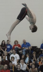 Lawrence high diver Skyler Criswell competes at the Sunflower League swimming and diving meet Saturday at Chisholm Trail Junior High in Olathe.