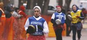 Amanda Curtis, foreground, leads Jessica Lash down the final stretch of the International Pancake Race in Liberal. Curtis won the U.S. leg of the race with a time of 66.3 seconds, beating Amanda Brear of Olney, England, who won the British leg with a time of 69 seconds.