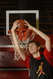 Lawrence High senior John Schneider has spent the last few years adjusting to life as one of the taller guys in his class. He quickly discovered that on the basketball court is where it helps him most.