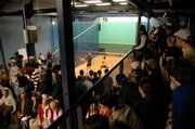 Spectators cram into lofts to watch Princeton play Trinity  College in squash. Trinity has surfaced as a national power in the Ivy League-dominated sport.