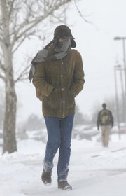 Kansas University freshman Kent Szlauderbach, 19, bundled up this morning for a walk to the campus library to study. KU canceled classes today - the first time since February 2004.