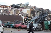 Cars are seen destroyed on the Union University campus Wednesday in Jackson, Tenn. At least 55 people were killed and hundreds injured Tuesday and Wednesday by dozens of tornadoes that plowed across Mississippi, Arkansas, Tennessee, Kentucky and Alabama. It was the nation's deadliest barrage of twisters in almost 23 years.
