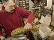 Brewmaster Steve Bradt of Free State Brewing Co., 636 Mass., measures out hops for the next day's brewing.