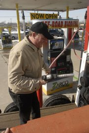 "Brian Conrad, of Eudora, uses the new Zarco 66 gas station at Ninth and Iowa streets Thursday to fill up his Bobcat tractor. The station offers several biofuels. ""I'm liking it; I saved 40 cents a gallon,"" he said. ""That makes it worth driving across town."""
