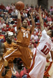 Texas' D.J. Augustin (14) shoots over Iowa State's Diante Garrett in the Longhorns' 71-65 overtime victory over Iowa State. Augustin leads UT in scoring heading into tonight's game with Kansas University.