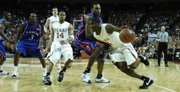 Kansas guard Brandon Rush looks to slow up Texas guard Justin Mason, right, on his way to the bucket. Mason had nine points and Rush 10 on Monday, Feb. 11, 2008 at the Frank Erwin Center in Austin..