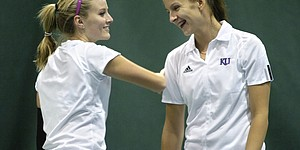 Kansas senior Lauren Hommell, left, and freshman Magdalena Tokarczyk congratulate each other during their match against Saint Louis. After falling to Illinois earlier Sunday, 5-2, the Jayhawks rallied for a 7-0 rout of Saint Louis at First Serve.