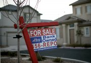 A bank-owned home was for sale last week in Las Vegas. In states hardest-hit by the housing bust, foreclosed homes represent a growing share of homes sold, and that number has risen above 50 percent lately in particularly hard-hit cities.
