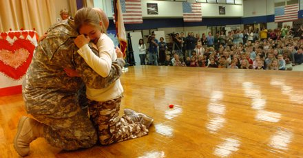 Sgt. Charles Bowen Of The Army National Guard 142nd Arkansas Field  Artillery Hugs His Daughter Kelsey, 11, On Wednesday At Sleepy Hollow Elementary  School ...