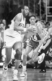 Danny Manning, left, prepares to pass against Duke in a 74-70 loss in Allen Fieldhouse. KU bounced back to beat the Blue Devils in the 1988 national semifinals, 66-59.