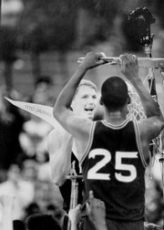 KU's Chris Piper and Danny Manning (25) cut down the nets after a 69-54 victory over Kansas State in Detroit secured a trip to the FInal Four.