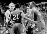 Jayhawks, from left, Chris Piper, Milt Newton, Scooter Barry and Danny Manning huddle during their semifinal victory over Duke in Kansas City, Mo.