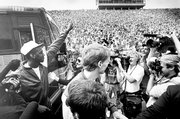 The Jayhawks arrive for a celebration in Memorial Stadium the day after winning the national title