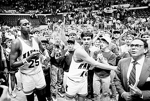 Danny Manning, left, Kevin Pritchard, center, and coach Larry Brown share a happy moment on the court with fans after a KU victory in Lincoln, Neb., during the 1988 NCAA Tournament's opening weekend.