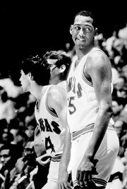 Danny Manning, right, and Kevin Pritchard watch the waning minutes of a KU victory from the bench.