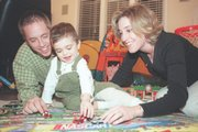 In this file photo from Jan. 4, 2001, two-year-old Miles Blomgren plays with his parents Dan and Jill Blomgren while recovering from a Nov. 2000 transplant operation where he received part of his father's liver.