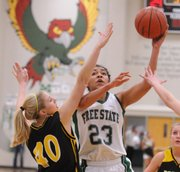 Free State's Chantay Caron hooks a shot around the SM West defense during West's victory at FSHS on Friday night.