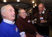 Former KU radio announcer Max Falkenstien, left, visits with ex-Jayhawk players Clyde Lovellette, center, and Jerry Waugh on Friday night at Lawrence Country Club.