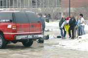 In this photo provided by the student-run Northern Star newspaper, rescue workers carry an unidentified victim from the scene of a shooting at a lecture hall Thursday at Northern Illinois University in DeKalb, Ill. A man dressed in black opened fire with a shotgun, killing five students from a stage of a lecture hall before he killed himself. The campus remains closed today.