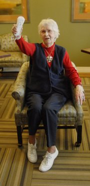 Virgie Pine, a resident at Brandon Woods, took her turn at the Nintendo Wii.