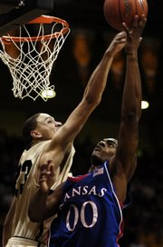 Colorado standout Richard Roby, left, tries to block a shot by Kansas University's Darrell Arthur in this Feb. 2 file photo. Roby has performed well against Kansas, but has an 0-7 record to show for it heading into today's KU-CU game.