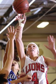 LHS junior Taylor bird (4) lets go of a shot. The Lions beat Leavenworth, 63-24, Friday.
