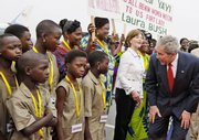 President Bush and first lady Laura Bush meet Beninese children as they participate in an arrival ceremony Saturday at Cadjehoun International Airport in Cotonou, Benin. Bush is visiting Benin, Tanzania, Rwanda, Ghana and Liberia on his Africa trip this week.