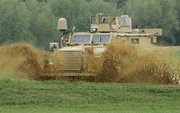A Category I mine-resistant ambush-protected (MRAP) vehicle, is driven on a test course during a media demonstration at the Aberdeen Proving Ground in Maryland in this Aug. 24, 2007, file photo. An internal military study concluded that hundreds of Marine lives could have been saved from road bombs in Iraq if bureaucrats had not refused a 2005 request for blast-resistant vehicles.