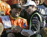 Tony Stewart, left, celebrates in Victory Lane with teammate Kyle Busch after winning the Camping World 300 Nationwide Series race. Stewart won Saturday in Daytona Beach, Fla.