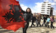 Students dance with the Albanian flag Saturday while celebrating the anticipated upcoming independence of Kosovo on the Albanian-dominated part of the ethnically divided town of Kosovska Mitrovica, Kosovo. Kosovo is widely expected to declare independence today.