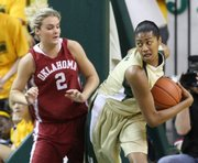 Baylor's Danielle Wilson, right, keeps the ball from Oklahoma's Jenny Vining in the second half of a college basketball game, Sunday in Waco, Texas.