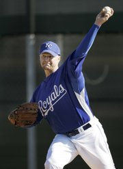Kansas City pitcher John Bale throws during spring training. The Royals continued practice Sunday in Surprise, Ariz.